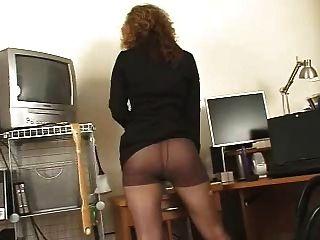 Secretaria secretaria pantyhose negro tacones altos solo