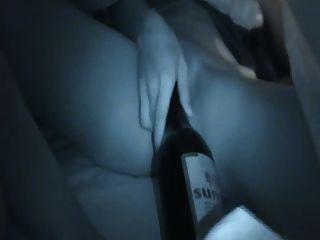 Masturbación china de la botella de la muchacha