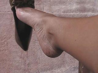 Los pies y la pierna atractivos tease