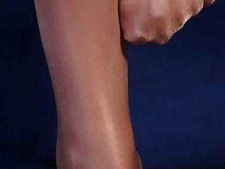 piernas sexy en pantyhose brillantes de alto brillo